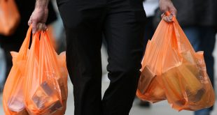 LONDON - FEBRUARY 29:  Shoppers leave a Sainsburys store with their purchases in plastic bags on February 29, 2008 in London, England. The Prime Minister Gordon Brown has stated that he will force retailers to help reduce the use of plastic bags if they do not do so voluntarily.  (Photo by Cate Gillon/Getty Images)