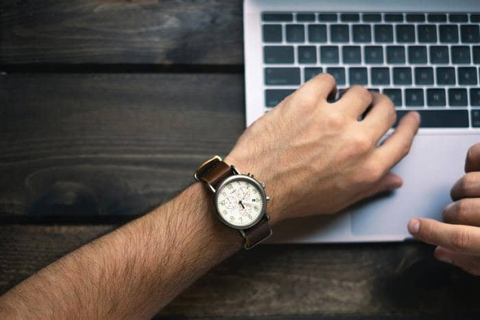 professional writer man's arm with a watch